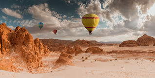 Hot Air Balloon travel over desert royalty free stock photos