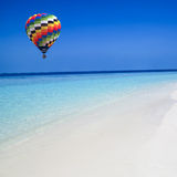 Hot air balloon travel over the sea Stock Photo
