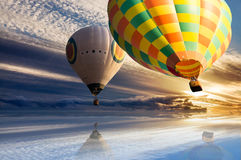 Hot air balloon travel over water. Surface royalty free stock photo