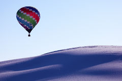 Hot air balloon and white sand dune Stock Photography