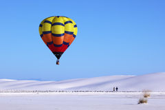Hot air balloon and white sand dune Royalty Free Stock Photo