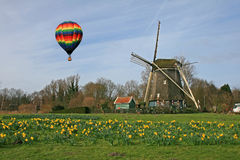 Hot air balloon and Windmill Stock Image