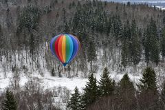 Hot air balloon in winter royalty free stock photography