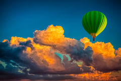 Hot Air Balloon With Cloudy Dramatic Sunset Background Stock Photo
