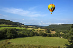 Hot Air Balloon - Yorkshire Dales - England. A hot air balloon flying over the countryside of the Yorkshire Dales in the north of England Royalty Free Stock Images