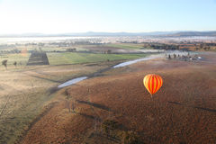 Hot Air Ballooning. Hot Air Balloon flight over Gold Coast Hinterland, Queensland, Australia at sunrise in mid winter Stock Image