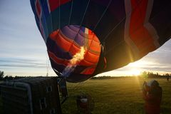 Preparing for flight at daybreak. Hot Air Ballooning on the Canterbury Plains. Early morning sunrise whilst testing the main burners Royalty Free Stock Image