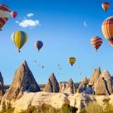 Hot air ballooning near Goreme, Cappadocia, Turkey. Sunny weather, limestone conical rocks near Goreme, Cappadocia, Turkey. Hot air ballooning is most popular royalty free stock photo