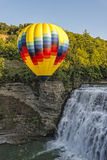 Hot Air Ballooning Over The Middle Falls At Letchworth State Par. Hot Air Balloon Flying Over The Middle Falls At Letchworth State Park In New York Royalty Free Stock Photography