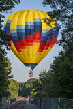 Hot Air Ballooning Over The Railroad Trestle Stock Photography