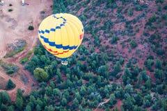 Hot air ballooning over sedona Arizona. Over red mountains royalty free stock photo