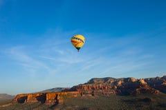Hot air ballooning over sedona Arizona showing balloon and butte. Hot air ballooning over Sedona Arizona showing red mountains and buttes also you can see second royalty free stock photos