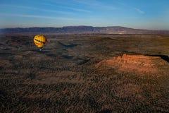 Hot air ballooning over sedona Arizona showing balloon and butte. Hot air ballooning over Sedona Arizona showing red mountains and buttes also you can see second royalty free stock image