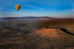 Hot air ballooning over sedona Arizona showing balloon and butte. Hot air ballooning over Sedona Arizona showing red mountains and buttes also you can see second stock photos