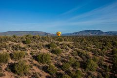 Hot air ballooning over sedona Arizona showing balloon and butte. Hot air ballooning over Sedona Arizona showing red mountains and buttes also you can see second stock image