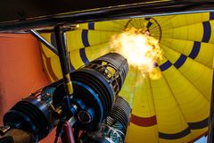 Hot air ballooning over sedona Arizona showing propane burner. And flame stock image