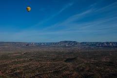 Hot air ballooning over sedona Arizona showing balloon and butte. Hot air ballooning over Sedona Arizona showing red mountains and buttes also you can see second stock photo