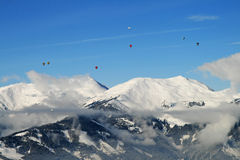 Hot air ballooning over the tops of mountains Royalty Free Stock Photography