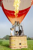 Hot air ballooning. ready for take off. A man blows hot air into the balloon in preparation for take off. near Sevlievo Bulgaria July 2018 stock image