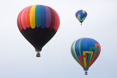 Hot Air Balloons. Three Hot Air Balloons Rising Stock Images