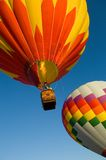 Hot Air Balloons. Beautiful hot air balloons against dark blue sky with basket Royalty Free Stock Photo