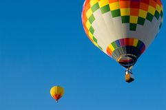 Hot Air Balloons. Beautiful hot air balloon against dark blue sky with basket Stock Image