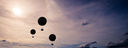 Hot air balloons. Three hot air balloon silhouettes against the sky Stock Photography