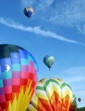 Hot Air Balloons. Colorful hot air balloon in the sky at the Quechee Vermont Hot Air Balloon Festival firing its propane tanks stock photos