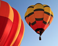 Hot air balloons. Two hot air balloons over blue sky Royalty Free Stock Photo