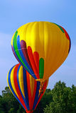 Hot Air Balloons. Rising above the treeline during Freedom Weekend Aloft Royalty Free Stock Photos
