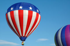 Hot Air Balloons. Colorful hot air balloons soaring in the blue summer sky royalty free stock photography