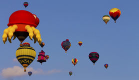 Hot air balloons. Including odd shaped ones stock images