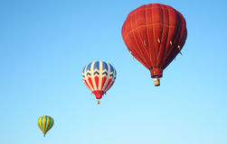 Hot air balloons. In the sky displaying their brilliant colors. Focus point is on center balloon Stock Photography