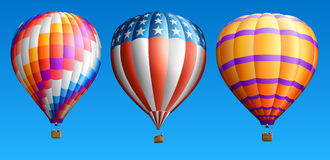 Hot air balloons. Set of hot air balloons, isolated on blue Royalty Free Stock Images