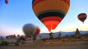 Hot air balloons. Rising at cappadocia, turkey stock video footage
