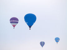 Hot air balloons. Hot air coloured balloons during a competition Royalty Free Stock Photography