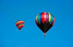 Hot Air Balloons. Two Hot Air Balloons Flying in a Clear Blue Sky Stock Images