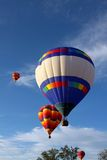 Hot air balloons. Taking off into a blue sky Stock Photography