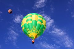 Hot air balloons. Two hot air balloons in a blue sky Stock Photography
