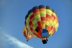 Hot air balloons 7. Two hot air balloons fly quite in the blue sky stock image