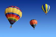 Hot air balloons. Colorful hot air balloons against a clear blue sky Stock Photos