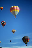 Hot air balloons against blue sky Royalty Free Stock Photo