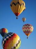 Hot air balloons against blue sky stock photos