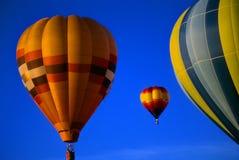 Hot air balloons agaisnt blue sky Stock Photography