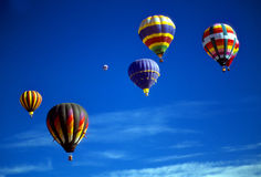 Hot air balloons agaisnt blue sky royalty free stock image
