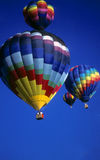 Hot air balloons agaisnt blue sky Stock Images