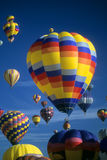 Hot air balloons agaisnt blue sky Stock Photography