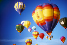 Hot air balloons agaisnt blue sky Stock Photos