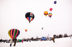 Hot Air Balloons ascend in the sky Hudson Hot Air Affair. Hot Air Balloons in the sky on a winter day in Hudson Wisconsin - Feb. 8 2014 Stock Photography