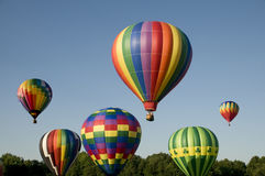 Hot-air balloons ascending or launching at a ballooning festival Stock Images